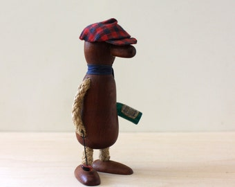 The Golfer. Mid century wood figurine collectible.