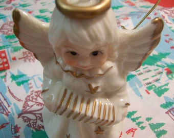little white and gold angel bell