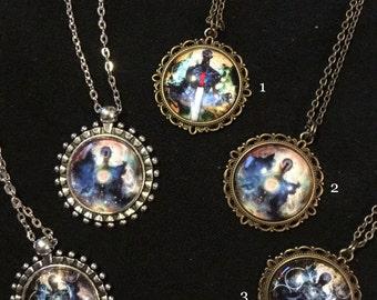 Bronze or silver pendant featuring Jesse Lindsay's cosmic surrealist art work