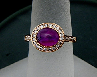 AAA Pink Star Sapphire Oval   7.8x6.3mm  2.25 Carats   14K Rose gold Halo engagement ring with .30 cts of diamonds. 785 MMM