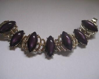 Gold Tone Panel Bracelet with Purple Poured Plastic Cabochons