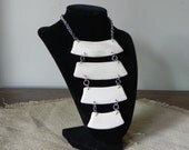 Vintage modern statement necklace four circular pieces linked vertically - plastic off white cream faux ivory