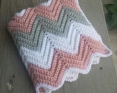 Crochet chevron baby car seat blanket with holes for car seat straps, strollers, shopping cart, or anything with a buckle.