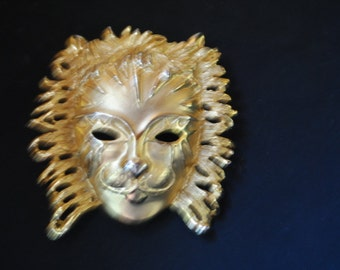 Retro vintage 80s gold tone metal, face mask brooch.