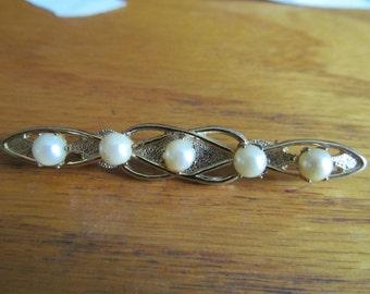 elegant pearl brooch