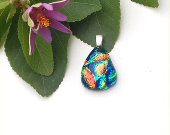 Fused dichroic glass pendant with orange and green