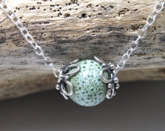 Minimalist sterling necklace with sterling capped light moss green porcelain bead