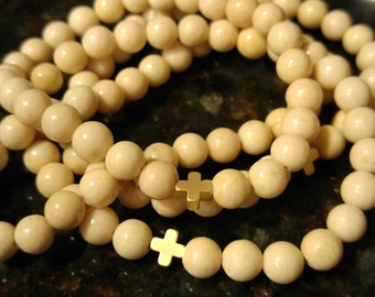 6mm White Riverstone Bead Bracelet with Gold or Silver Cross Charm