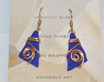 Wire wrapped Earrings-Cobalt blue tumbled glass earrings wrapped with gold wire. Beach jewelry from Maine for fall fashion accessory