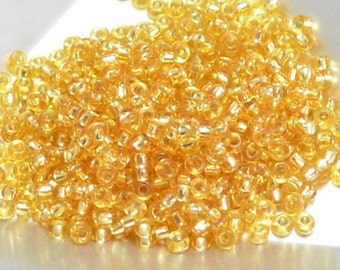 11/0 Japanese Seed Beads - Silver Lined Gold 3