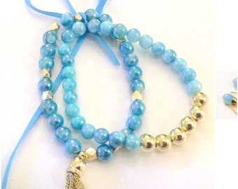 Caribbean Blue,Teal,and Gold Strechy Shell Beaded Bracelet Set SALE was 17.00
