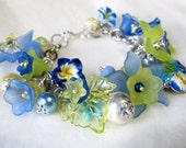 BLUE and YELLOW BRACELET Softly Hued Flowers and Butterfly Fancy Charm Style Beaded Bracelet