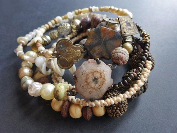Oblivion Ends the Coil. Assemblage bangle stack, bracelet set in earthy neutrals.