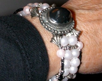 Bracelet of Costume Jewelry Faux Pearls and Findings on Memory Wire with Black Onyx Cabochon