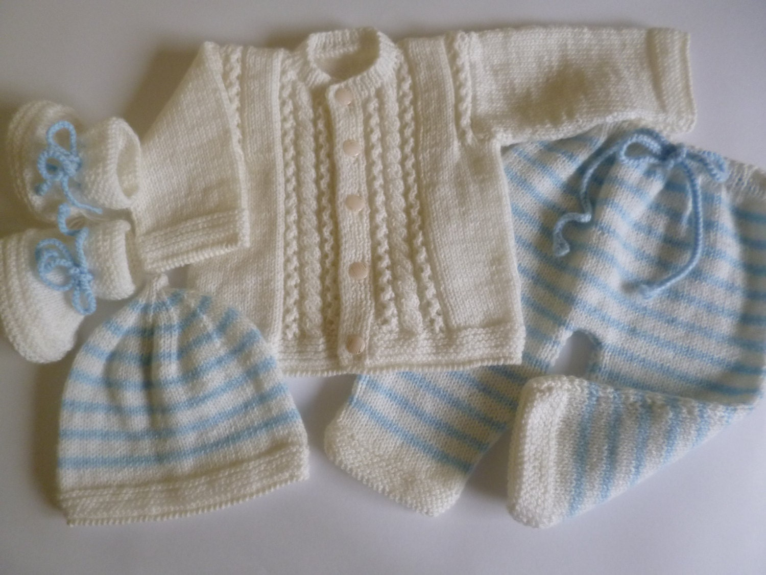 JuneBee Baby, Inc. specializes in fair trade handmade Cotton Bamboo baby clothes.