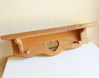 Farmhouse Style Wood Heart Wall Shelf with Wooden Pegs for Hanging