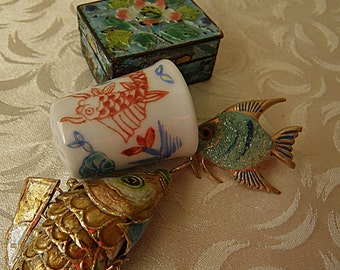 articulated fish, tiny chinese enameled box, koi fish thimble, tiny fish pin