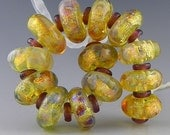 a set of 13 glowing golden discs with fine silver and silverglass handmade lampwork beads - Temple of the Sun