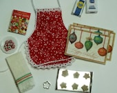 Holiday Kitchen Accessories Set with Red Patterned Apron and Ornament Place Mats