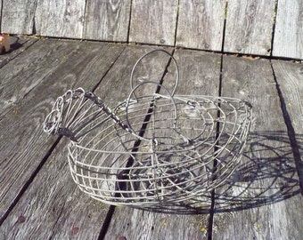 Vintage small wire chicken in a basket