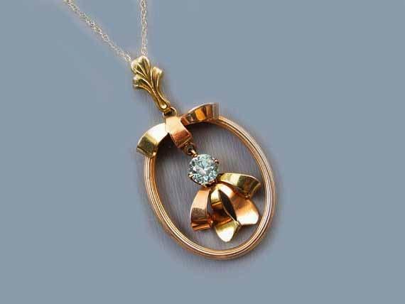 Vintage Retro Moderne ribbon bow shaped 10k gold genuine blue zircon pendant necklace signed Esemco Shiman Brothers