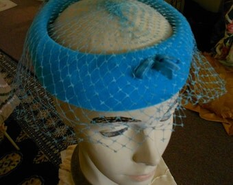 "1950's, 22"", turquoise blue velvet circle with veil"