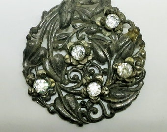 An Antique Brooch in Cast Metal and Rhinestones
