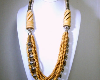 Tribal Bone and Silver Bead Necklace, 9 Full Long Strands Gathered By Chunky Carved OXBone Tubes,  Boho Beads, 1980s, Aged Cream Color