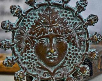Brass face... antiqued pendant...  patina... Lf