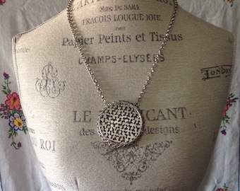 Vintage silver toned disk necklace