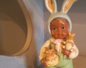 Vintage Musical Easter Boy in Bunny Costume with Rabbits and Flowers ~ Musical Figurine