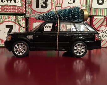 Range Rover Carrying Christmas Tree Ornament
