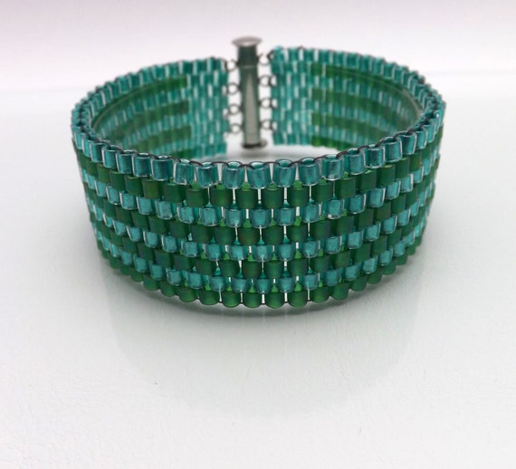 """Peyote Stitch Bracelet -Cuff Style in Emerald Green & Aqua beads-7"""" long with a slider magnetic clasp SKU: BR1006"""