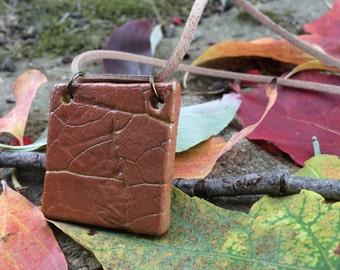 Square Leaf Impression Ceramic Pendant Necklace - terracotta ceramic leaf necklace - burnt orange with golden accents brown leather cord