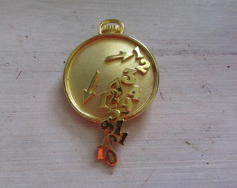 Fun Vintage Casual Corner Gold Tone Pin Time is RUNNING OUT Clock with Falling Numbers