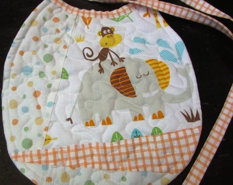 Reversible quilted baby bib gender neutral with animals