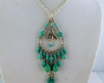 "Boho style Silver Celtic Trinity Knot Pendant necklace on an 18"" silver chain made with Turquoise Glass beads"