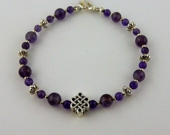 Genuine Amethyst gemstone bracelet with a Silver Celtic Knot focal bead
