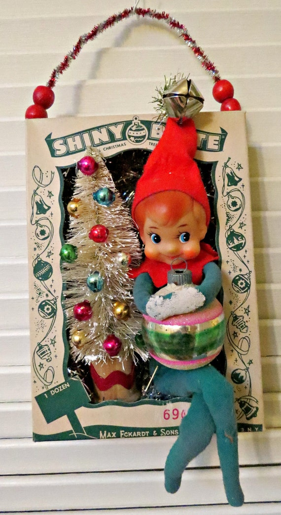 Vintage ornament box with shiny and brite christmas wall
