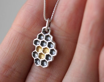 Silver honeycomb pendant with gold honey details and sterling silver box chain