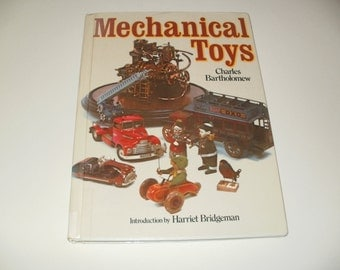 Mechanical Toys by Charles Bartholomew - Toy Banks, Metal Toys, Dolls, Collectibles