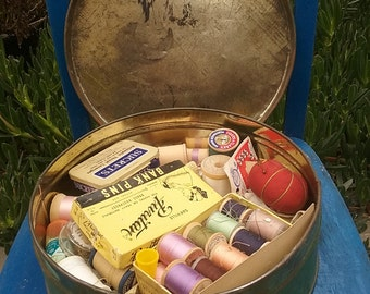 Large Round Tin Of Hand Sewing Supplies Needles Pins Thread Buttons Snaps Measuring Fabric Tape