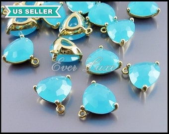2 ocean blue / blue turquoise color glass crystal charms, glass crystal in gold setting pendants, triangle shape 5127G-OB