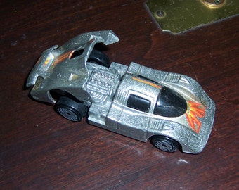 Hot Wheels Sol Aire CX4, 1983 Mattel, Inc., Die Cast Metal Toy, Silver with Red Flames, Black Plastic Tires, Hood Opens, Malaysia