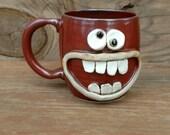 Cinnamon Red Coffee Cup. Ceramic Stoneware Pottery. Nelson Studio Ug Chug Face Mug. Happy Smiley Face 16 Ounce Mug.