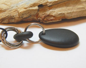Beach stone necklace, black stones, heavy jump rings, black leather, adjustable sliding knot, arthritis friendly