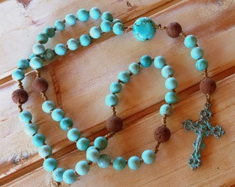 Turquoise magnesite rosary with red lava and bronze verdigris crucifix