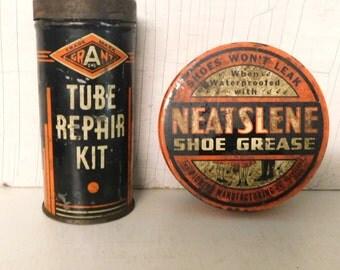 Two vintage metal tins Orange and Black Graphics/Tube Repair Kit/Neatslene Shoe Grease