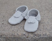 Light grey suede moccasins for babies and toddlers