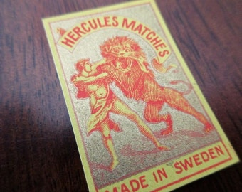 1910 antique Swedish matchbox paper - unused, label, Hercules, gold, lion
